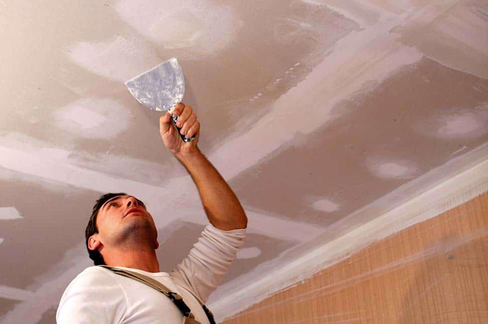 plaster ceiling repair team on work